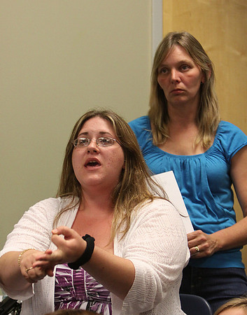 Salem: Megan Romanovitz, left, speaks to the large crowd that crammed into the Enterprise Center Conference Room at Salem State College on Tuesday evening. Romanovitz and her neighbor, Dede Kinsella, right, have strongly denounced the proposed methadone clinic on Canal Street, and were the first to start alerting Salem residents and formed a petition. Photo by David Le/Salem News