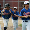 Danvers: From left, Matt Andreas, Devonn Allen, Jeremy Koen, Cam Borenstein, and Courtney Cashman of the Danvers American eleven year-old All-Star team head back to the dugout after celebrating Allen's home run. Danvers American squared off against Peabody West in the Jimmy Fund eleven year-old Championship Game at Tapley Field in Danvers on Saturday afternoon, which Danvers won 8-7 in dramatic fashion. Photo by David Le/Salem News