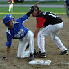 Peabody leadoff hitter Jake Gustin, left, looks up for a safe call after sliding into third base. David Le/Staff Photo