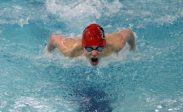 Marblehead's Harrison Rodts competes in the 100 yard Butterfly against Beverly. David Le/Salem News