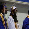 Danvers: From left, High School Class Officers, Rebecca Leslie, Mohamed Najia, and Stephanie Costa, laugh at Gregory Ladd's address to their classmates. Danvers High School had their commencement ceremonies on Saturday afternoon in the high school gymnasium. Photo by David Le/Salem News