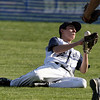 Hamilton-Wenham right fielder Nick Tufts slides but cannot hang onto a bloop single by a North Reading player on Tuesday afternoon. David Le/Staff Photo