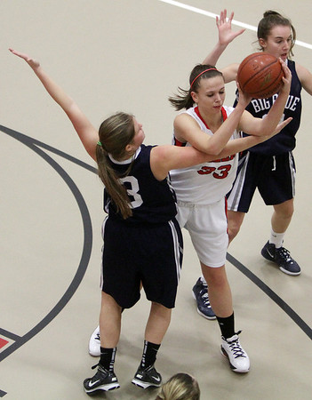 Salem High School's Courtney Shearstone (33) passes to a teammate while Swampscott's Jessie DePaolo (3) applies pressure. David Le/Salem News.