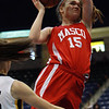 Masco senior Danielle Davis (15) soars in for a layup against Andover on Saturday during the D1 North Final at the Tsongas Center. David Le/Staff Photo