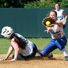 Danvers High School second baseman Chrissy Gikas reaches out to get a throw from third baseman Caitlin McBride, but is too late to tag out Dracut baserunner Kaleigh Bishop-Kotarba. David Le/Staff Photo