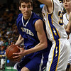 Danvers junior Dan Connors (31) left, looks to get to the hoop against Wareham's Danny Thomas (30) right, during the D3 State Semi-Final at the TD Garden on Monday afternoon. David Le/Staff Photo