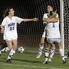 Peabody High School junior Victoria Digiacomo, center, is mobbed by teammate Katie Brunnelle (1) and Madison Doherty (20) after Digiacomo drove home a deflected shot and gave the Tanners a 2-1 win over Oliver Ames. David Le/Salem News
