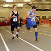 Beverly: Beverly's Bruno Caetano, left, and Danvers' Mike Mazola, right, finish neck and neck in the 300m race on Thursday David Le/Salem News