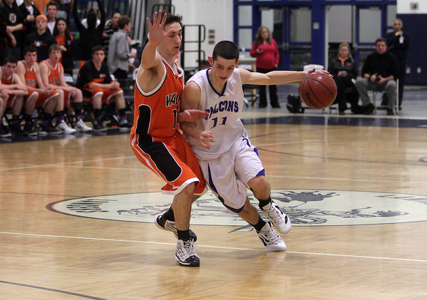 Danvers junior guard Eric Martin drives to the hoop against Wayland. David Le/Staff Photo
