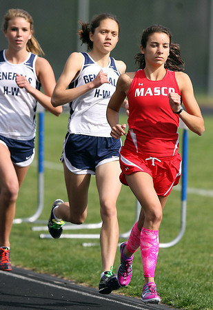 Masco's Lily D'Agostino, right, and Hamilton-Wenham's Kerry Phelan, middle, and Sarah Duffy, left, compete in the two-mile on Wednesday afternoon. David Le/Staff Photo