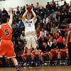 Danvers junior Nick Bates (15) rises up and drains a three point shot against Wayland. David Le/Staff Photo