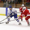 Salem: Danvers' Jack Doyle takes a shot on net while being pressured by a Saugus defender.David Le/Salem News