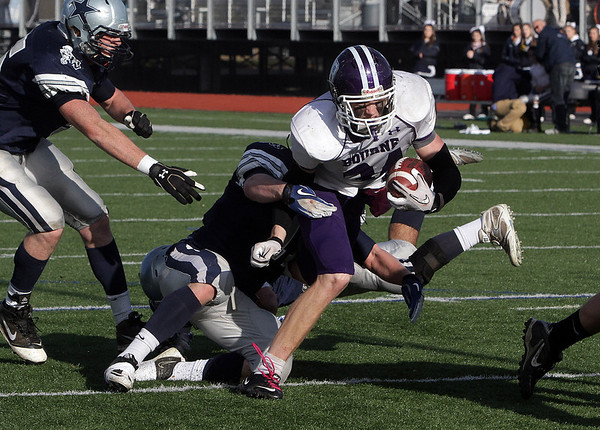 Hamilton-Wenham's Luke Wendt drags down Bourne runningback Jacob Achstetter before he can get into the endzone. David Le/Salem News