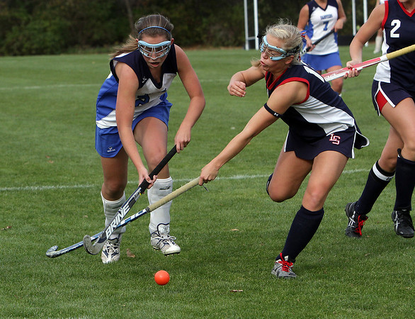 Danvers High School sophmore Rachel Trocchi carries the ball upfield while being pressured by Lincoln-Sudbury's Annika Hygren on Thursday afternoon. David Le/Salem News