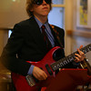 Miles River Middle School 8th grader Alex MacLean plays a guitar solo during the jazz band performance on Wednesday afternoon. David Le/Staff Photo