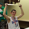 Danvers junior Eric Martin lifts the D3 State Championship Trophy over his head after talking with the media at the DCU Center in Worcester on Saturday afternoon. David Le/Staff Photo