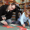 Dan Levine, of Marblehead and his daughter Sarah, 6, work to make holiday ornaments at Wit and Whimsy on Sunday afternoon. David Le/Salem News