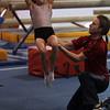 Yellowjackets gymnast instructor Tim Kormann, right, spots gymnast Emme Reppas as she does a back flip. David Le/Staff Photo.