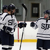 St. John's Prep senior captain Sam Kurker (9) center, gets congratulated on a goal by teammates Tyler Bird (14) left, and Andrew Brandano (17) right. David Le/Staff Photo