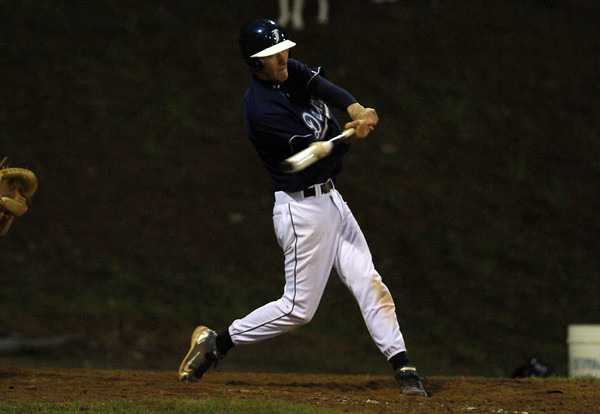 Danvers second baseman Dan Connors makes contact against Peabody on Wednesday evening. David Le/Staff Photo