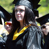 Endicott College senior Kat McDermott listens to speeches during Commencement on Saturday morning. David Le/Staff Photo