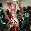 Beverly: Beverly junior Dom Abate (11) rises up in a crowd of Lynn Classical defenders and drains a shot.  David Le/Salem News