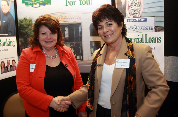 Laurene Wessel, of Bank Gloucester left, and Lisa Martin, right, of Martin and Company, at the North Shore Chamber Business Expo held at the Sheraton Ferncroft. David Le/Staff Photo