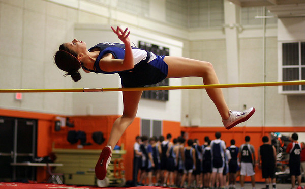 Peabody high jumper Amanda Nielsen leaps high over the bar on Thursday. David Le/Salem News