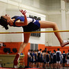 Peabody high jumper Amanda Nielsen leaps high over the bar on Thursday. David Le/Salem News