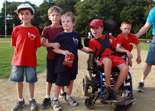 From left, Zachary Miraglia, 9. Connor and Patrick Bell, both 7, Ryan Barrett, 12, and Manny Thompson, 10, pose for a photo after the Challenger Game at Harry Ball Field. David Le/Staff Photo