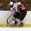 Beverly's Matt Hamar (9) controls the puck while being checked by Gloucester's Pete Mondello (12). David Le/Salem News