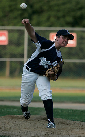 Ipswich: Hamilton-Wenham starting pitcher Austen Michel delivers a pitch in the first inning of H-W's game against Peabody West on Tuesday evening at Bowen Field in Ipswich. Photo by David Le/Salem News