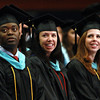 Salem State University Graduate students, from left, Leslie Lartey, Kristen LeBlanc, and Erika Lofstrom, watch their fellow classmates march in during the Graduate Studies Commencement ceremony on Thursday afternoon. David Le/Staff Photo