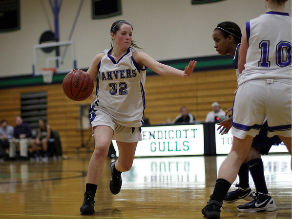 Beverly: Danvers' Kasey Sherry (32) runs around the screen of teammate Emily McNulty (10) right, against Winthrop at Endicott College. David Le/Salem News