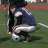 Hamilton-Wenham quarterback Steve Brao kneels on the sidelines after the Generals turned the ball over on downs to give Bourne High School the victory in the DIII A Superbowl at Manning Field in Lynn. David Le/Salem News