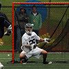 St. John's Prep goalie Tom Casale keeps his eye on the ball as he makes a save against Xaverian on Tuesday afternoon. David Le/Staff Photo