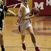Masco senior Chelsea Nason drives into the lane against Cambridge on Thursday night. David Le/Salem News