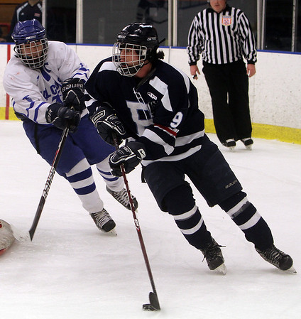 Beverly: Peabody's Mike Chiappini carries the puck while being pressured by Danvers' JD Hodgkins. David Le/Salem News