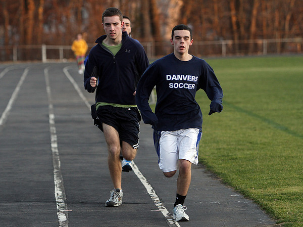 Danvers High School track runners Matt Hogan, right, and Mike Drew, do a track workout on Thursday afternoon. David Le/Salem News