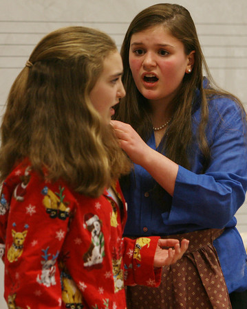 Miles River Middle School 7th graders Katie Ryan, left, and Mary Brao, right, perform a scene from an original skit written by their classmates on Wednesday night. David Le/Staff Photo