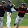 Beverly first baseman Kevin Cuneo gets a fist bump from third base coach Joel Belmonte after hitting a home run to left against Danvers on Thursday afternoon. David Le/Staff Photo