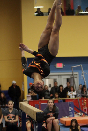 Beverly's Heather Gomes flips off the balance beam at the end of her routine on Friday night. David Le/Salem News