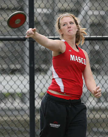 Masco senior Katie Hutchinson throws the discus against Hamilton-Wenham on Wednesday afternoon. David Le/Staff Photo