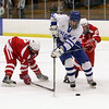 Salem: Danvers' AJ Couto weaves in between two Saugus defenders and roofs a backhand shot for a goal. David Le/Salem News