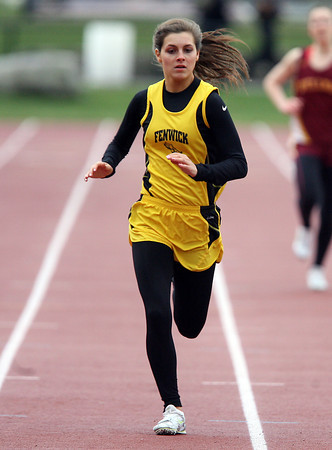 Bishop Fenwick senior Jess Patnaude sprints towards the finish in the 400 against Spellman on Thursday afternoon. David Le/Staff Photo