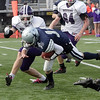 Hamilton-Wenham quarterback Trevor Lyons (12) dives forward for a few extra yards against Bourne High School on Saturday afternoon. David Le/Salem News