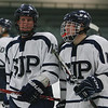 St. John's Prep teammates Paul Crehan (13) left, and Andrew Brandano (17) right, leave the ice after defeating Austin Prep. David Le/Staff Photo