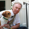 John Archer sits on the steps of his home at 10 North St. in Danvers with one of his dogs, Mark.  David Le/Staff Photo
