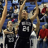 Swampscott's Ara Talkov (24) grabs a rebound in a crowd of people against Peabody. David Le/Salem News
