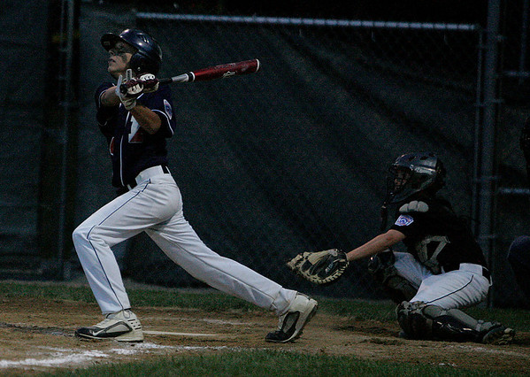 Beverly: Peabody West slugging shortstop Traverse Briana admires his second monster home run of the game against Beverly West pitching in the third inning of their game on Friday evening at Harry Ball Field in Beverly. Photo by David Le/Salem News